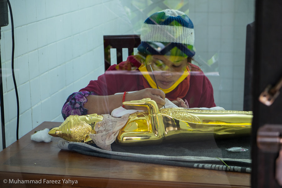 Gold plating of Buddha Status at Artisans Angkor